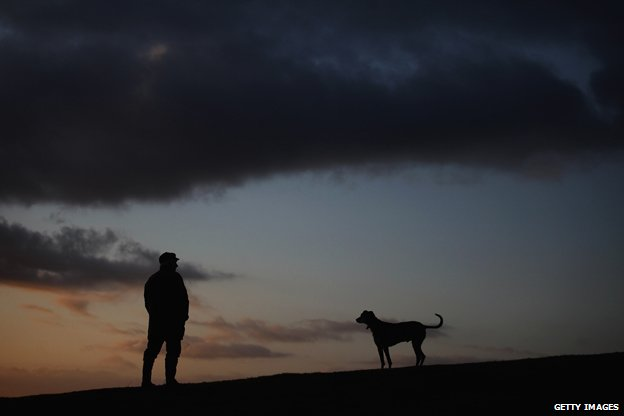 Man and dog on dark winter morning