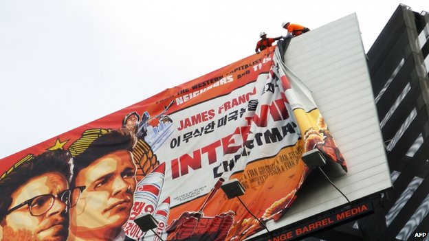 The Interview poster being removed