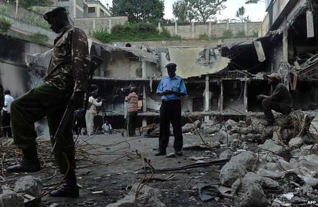 A soldier stands guard during a tour, on January 21, 2014, of the destroyed Westgate mall in Nairobi