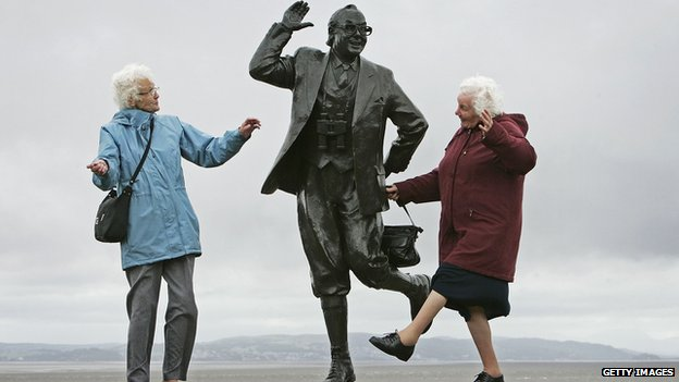 Old ladies dancing by statue of Eric Morecambe