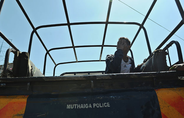 A Somali man in Eastleigh is taken away for questioning in April 2014