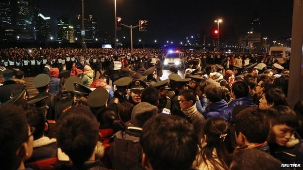 "Police control the site after a stampede occurred during a New Year""s celebration on the Bund, a waterfront area in central Shanghai, 1 January 2015."