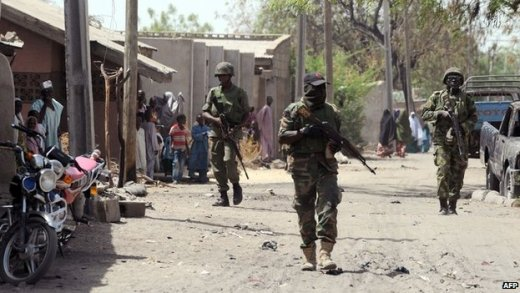 Nigerian troops patrolling in the streets of the remote northeast town of Baga, Borno State on 30 April 2013