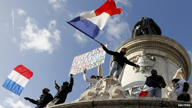 People flying French flags take part in a solidarity march in Paris - 11 January 2015