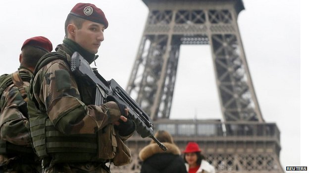 French soldier patrol near the Eiffel Tower in Paris as part of security measures following the attack on the offices of Charlie Hebdo magazine - 9 January 2015
