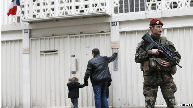 Soldier standing guard outside a Jewish school in Paris, 12 January 2015