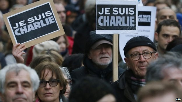 """People hold signs reading """"Je suis Charlie"""" during a unity rally in Paris. Photo: 11 January 2015"""