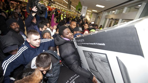 Shoppers at the Asda store in Wembley, north west London, take advantage of the stores Black Friday offers