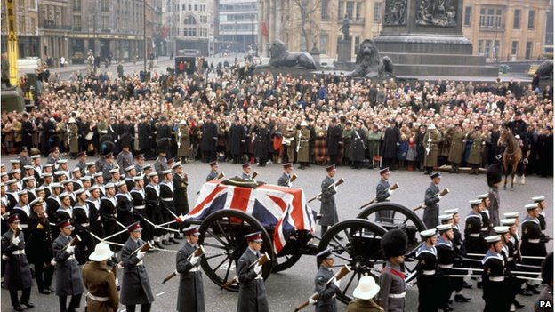 Churchill's coffin in a procession passing through Trafalgar Square