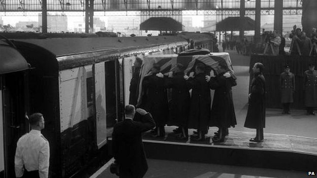 Churchill's coffin being loaded on to a train at Waterloo station