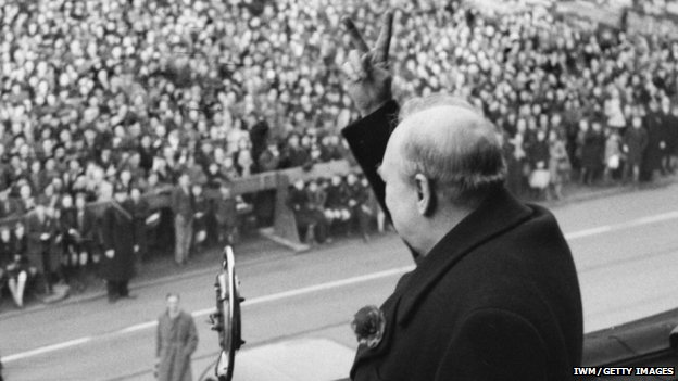 Sir Winston Churchill displays a v sign to crowd