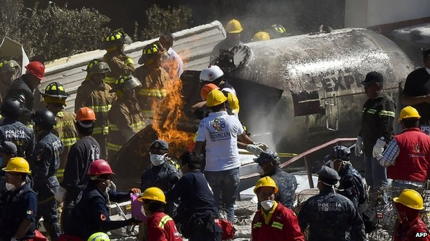 Rescuers work amid the wreckage caused by an explosion in a hospital in Cuajimalpa, Mexico City