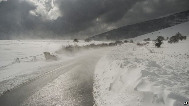 The wind blows snow on a road, in Lizarraga northern Spain, Wednesday, 4 February 2015.