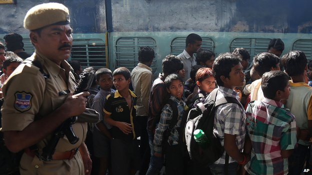 Indian rescued child labourers stand in a queue to board a train to be reunited with their parents in Bihar, one of India's poorest states, at a railway station in Hyderabad, India, Thursday, Feb. 5, 2015