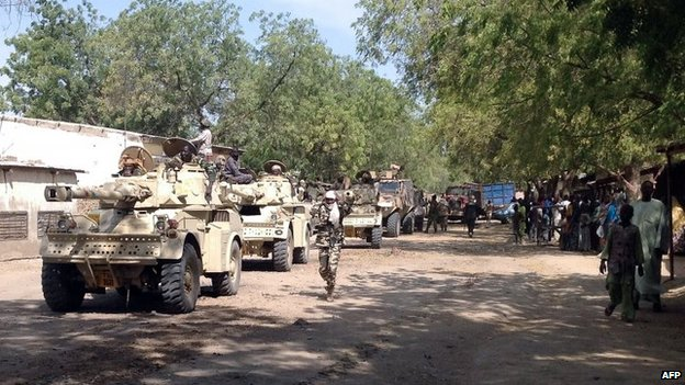 Soldiers patrol with military vehicles in the Cameroonian town of Fotokol, on the border with Nigeria, on 3 February 2015.