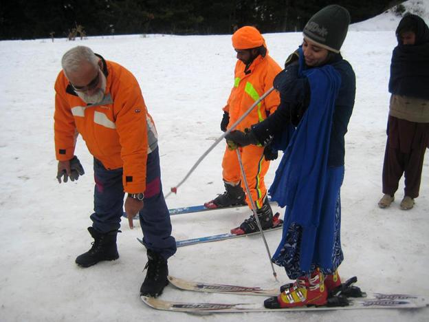 Matee Ullah Khan speaking to someone on skis
