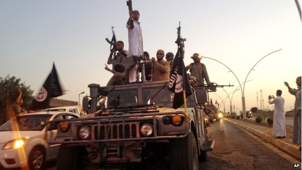 IS fighters parade in Mosul