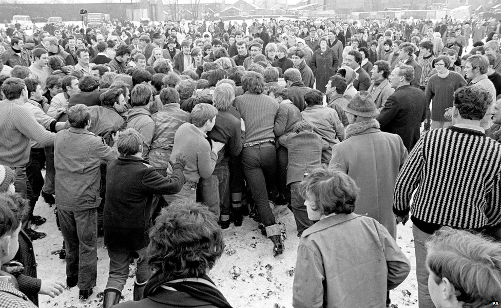 The ball is obscured in the 'hug' during the Shrovetide football game in Ashbourne 1969