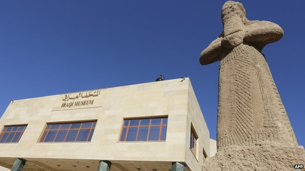 A statue dating back to the 8th Century BC is displayed at the entrance of Iraq's national museum during its official reopening on February 28, 2015