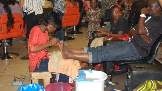 A pedicurist at work in Bruno's Place hair salon in Ikeja Mall in Lagos, Nigeria