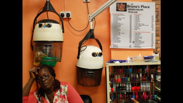 A worker at Bruno's Place hair salon in Ikeja Mall in Lagos, Nigeria