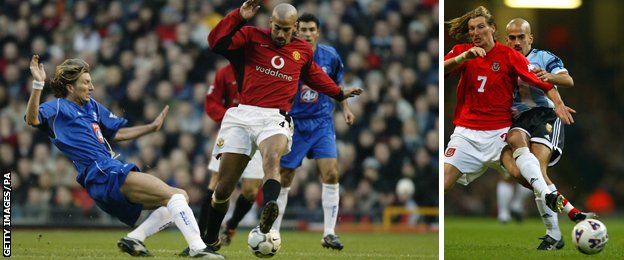 Robbie Savage, playing for Birmingham and Wales tackles Juan Sebastian Veron, playing for Manchester United and Argentina