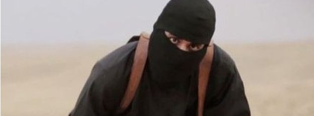 Mohammed Emwazi wearing a mask, dressed all in black