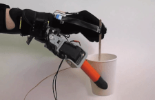 7 finger robotic mount stirring mug of tea