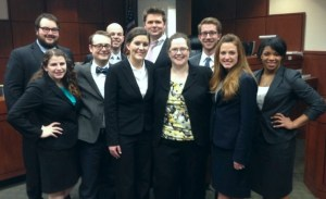 Pictured are (front row, l-r) Sara Page, Robert Martin, Rachel Hogan, Prof. Amy Moore, Emily Cole, and Ardath Griffin; (back row, l-r) Dayne Geyer, Ron Laffitte, Atty. Andrew Caple-Shaw and Patrick Ober.