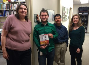 Nick Williams gifts copies of the book to Dr. Bill Hooper, Dr. Sarah Ann Fleming and Dr. Joyce Crowell in the Department of Mathematics and Computer Science.