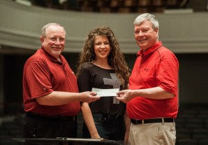 Bob Black, Jaimee Paul and Belmont Professor of Music Dr. Robert Gregg celebrate the orchestra donation.