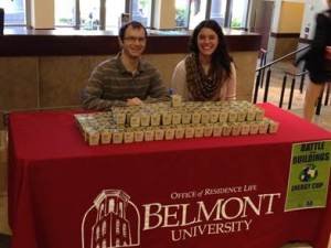 ( L – R) Residence Hall Directors Nathan Hendrix and Danielle Steffa pass out marigolds to students