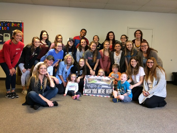 The art camp participants pose with the Belmont student volunteers.