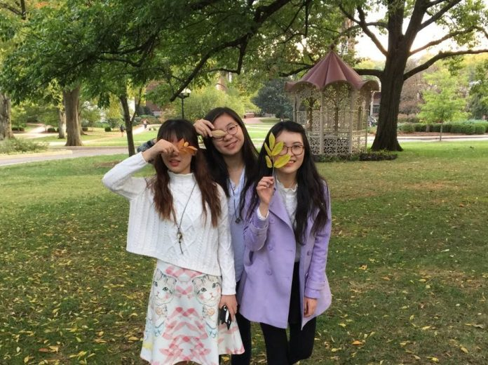 Three of the Chinese exchange students standing on Belmont's quad