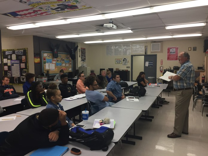 Dr. Steve Murphree presents to children in a local classroom.