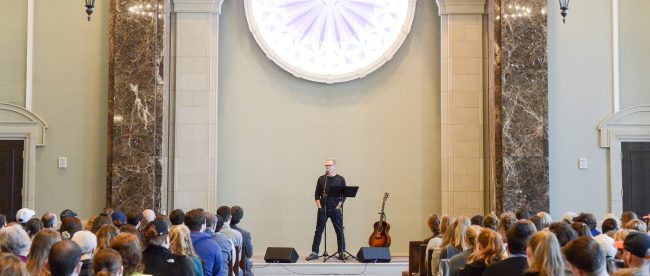 Chapman speaking to students at Chapel