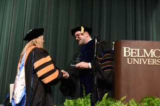 Dr. Adam receives her award from Provost Dr. Thomas Burns