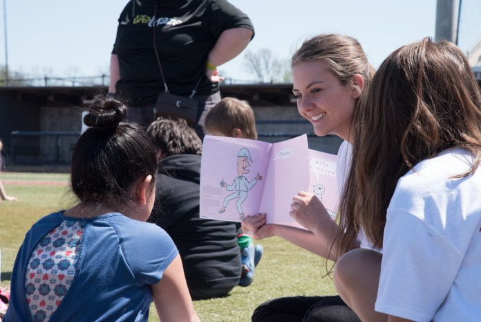 Students read to children at Family Literacy Day on April 8