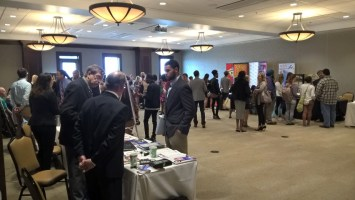 Students conversing with media organizations at the Career Fair