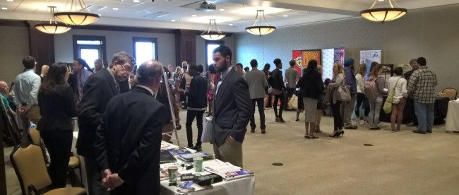 Students conversing with media organizations at the Career Fair