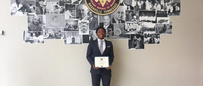Jordan Patrick poses with his certificate at Meharry.