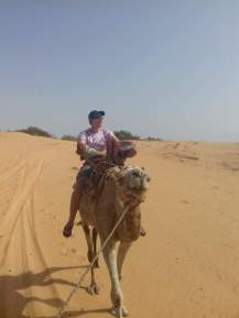 Grossnickle rides a camel while in Senegal.