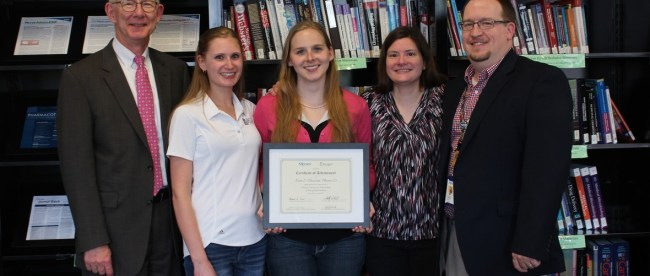 Fellow, Dr. Kate Claussen, poses with members of the Belmont College of Pharmacy