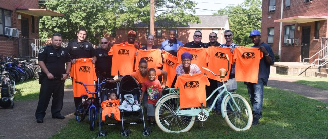 Belmont security officers donate bicycles to members of the Edgehill Bike Club