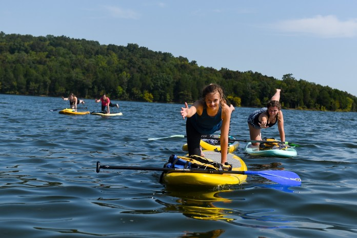 Student do paddle board yoga at the lake at Belmont University in Nashville, Tenn. September 9, 2017.