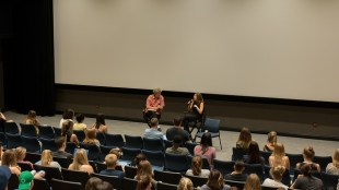 Leslie speaks to a group of students