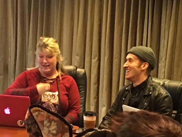 Gino and Jodi sitting at a table, smiling