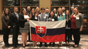 Belmont Model UN group holding their Slovakia flag
