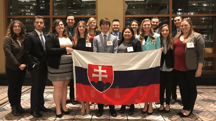 Belmont Model UN group holding their Slovakia flag