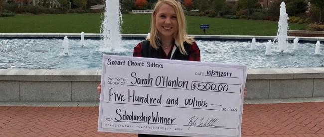 Sarah O'Hanlon holding over-sized scholarship check
